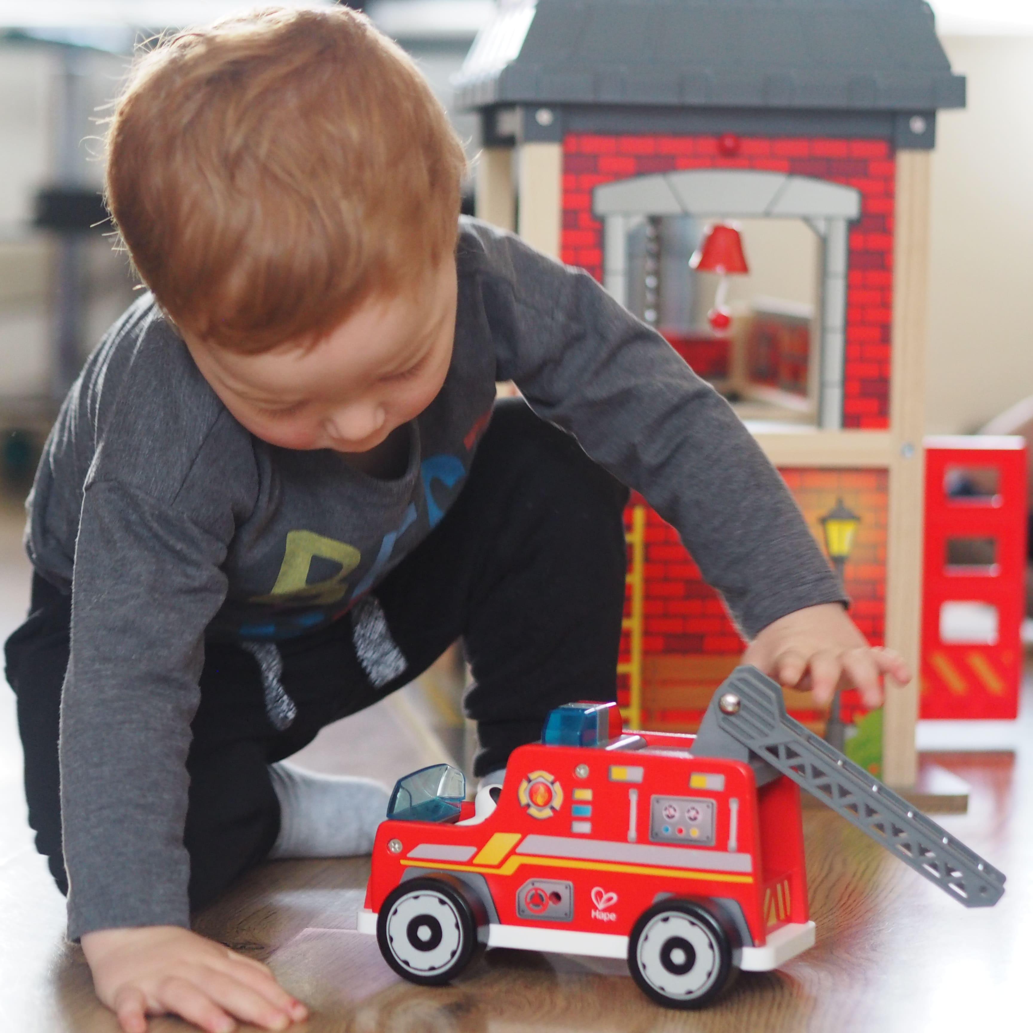 Cameo Playing with Hape Fire Engine - Chiino.co.uk